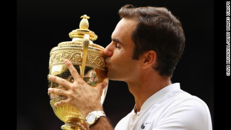LONDON, ENGLAND - JULY 16:  Roger Federer of Switzerland kisses the trophy as he celebrates victory after the Gentlemen's Singles final against  Marin Cilic of Croatia on day thirteen of the Wimbledon Lawn Tennis Championships at the All England Lawn Tennis and Croquet Club at Wimbledon on July 16, 2017 in London, England.  (Photo by Clive Brunskill/Getty Images) *** BESTPIX ***