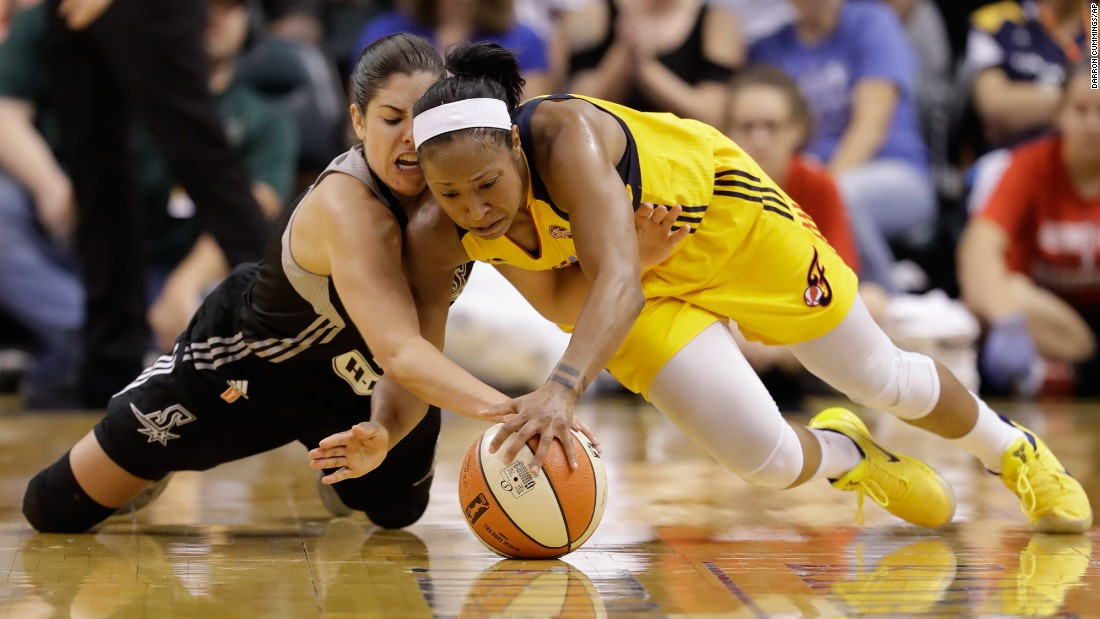 San Antonio Stars' Kelsey Plum, left, and Indiana Fever's Briann January dive for a loose ball during the second half of a WNBA basketball game on Wednesday, July 12, in Indianapolis. San Antonio defeated Indiana 79-72.