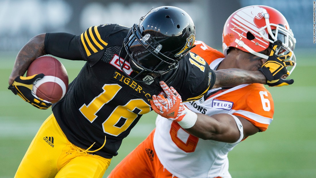 Hamilton Tiger-Cats' Brandon Banks, left, pushes off BC Lions defensive back T.J. Lee during a Canadian Football League game in Ontario on Saturday, July 15.