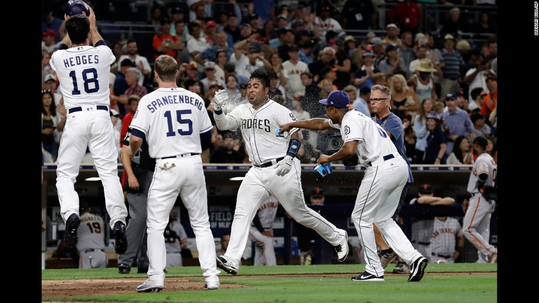 San Diego Padres' Hector Sanchez, second from right, is doused by teammates after hitting a two-run walk-off home run during the ninth inning against the San Francisco Giants on Saturday, July 15.