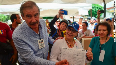 Former Mexican president Vicente Fox (L), named by the Venezuelan opposition as an observer to the opposition-organized vote to measure public support for Venezuelan President Nicolas Maduro's plan to rewrite the constitution, is pictured at a polling station in Caracas on July 16, 2017. Authorities have refused to greenlight the vote that has been presented as an act of civil disobedience and supporters of Maduro are boycotting it. Protests against Maduro since April 1 have brought thousands to the streets demanding elections, but has also left 95 people dead, according to an official toll.  / AFP PHOTO / Ronaldo SCHEMIDT        (Photo credit should read RONALDO SCHEMIDT/AFP/Getty Images)