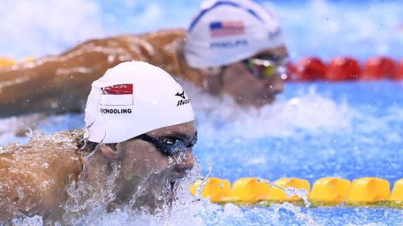 Schooling and Phelps, side by side.