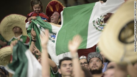 Fans of Mexico show their support during the CONCACAF Gold Cup soccer match against Curacao at the Alamodome on July 16, 2017 in San Antonio, Texas.      / AFP PHOTO / Brendan SMIALOWSKI        (Photo credit should read BRENDAN SMIALOWSKI/AFP/Getty Images)