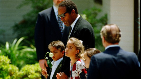 Simpson and his children attend Nicole Brown Simpson's funeral in June 1994.