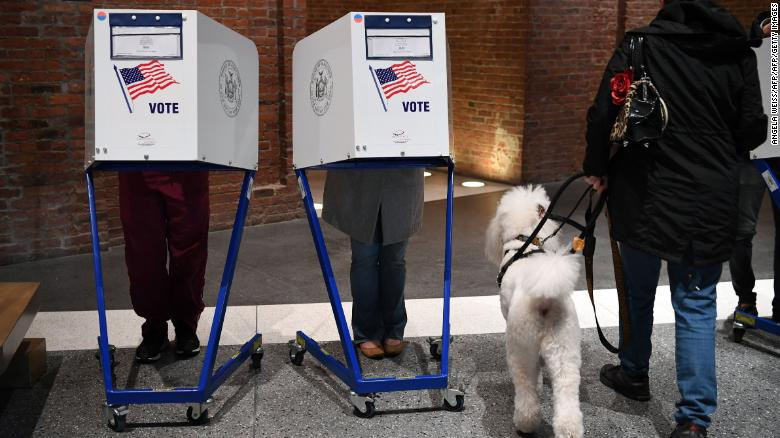 People vote at the Brooklyn Museum polling station in the Brooklyn borough of New York City on November 8, 2016. With an anxious world watching, Americans began voting Tuesday on whether to send the first female president or a volatile populist tycoon to the White House. The kickoff marks the end to a campaign like no other -- exhausting, often bitter -- as Hillary Clinton and Donald Trump presented radically different visions of how to lead the world's greatest power. / AFP / ANGELA WEISS        (Photo credit should read ANGELA WEISS/AFP/Getty Images)
