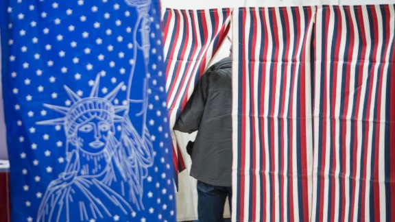 Voters head to the polling booths inside the Webster School gymnasium February 9, 2016 in Manchester, New Hampshire.