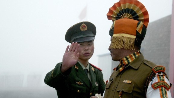 In this photograph taken on July 10, 2008, A Chinese soldier gestures as he stands near an Indian soldier on the Chinese side of the ancient Nathu La border crossing between India and China. AFP PHOTO/Diptendu DUTTA/Getty Images