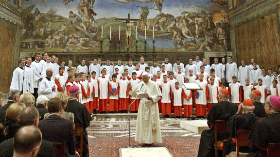 Pope Benedict XVI attends a concert by the Regensburger Domspatzen boys choir at the Sistine Chapel, on October 22, 2005.
