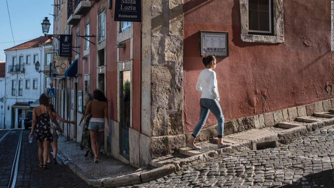 <strong>Lisbon:</strong> The historic Castelo neighborhood, dominated by the Moorish castle of São Jorge, offers traditional architecture and dramatic hilltop views. <br />