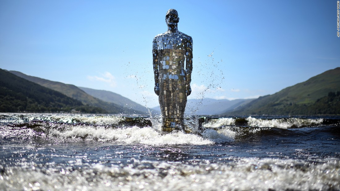 <strong>Loch Earn, Scotland:</strong> St Fillans locals know when it's summertime because Rob Mulholland's Mirror Man statue returns to the waters of Loch Earn for its fair-weather residency. When winter rolls around, the three-meter-tall sculpture returns to storage. <br />