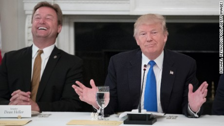 WASHINGTON, DC - JULY 19: (AFP OUT) US President Donald Trump (R) delivers remarks on health care and Republicans' inability thus far to replace or repeal the Affordable Care Act, beside Sen. Dean Heller (R-NV) (L) during a lunch with members of Congress in the State Dining Room of the White House on July 19, 2017 in Washington, DC. (Photo by Michael Reynolds - Pool/Getty Images)