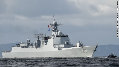 The Yinchuan (175), a Type 052D destroyer of China's People's Liberation Army Navy (PLAN), provides an escort ahead of the Liaoning aircraft carrier as it arrives in Hong Kong.