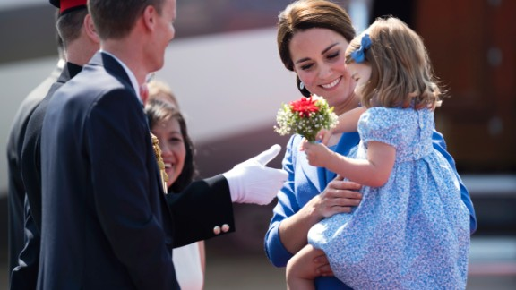 Britain's Princess Kate, the Duchess of Cambridge holds her daughter Princess Charlotte as they arrive at the airport in Berlin on July 19, 2017. The British royal couple is on a three-day-visit in Germany. / AFP PHOTO / Steffi LOOS        (Photo credit should read STEFFI LOOS/AFP/Getty Images)