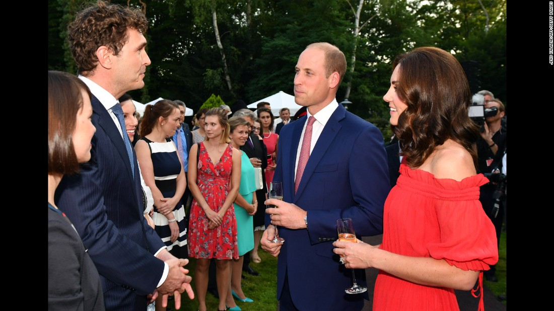 The royal couple speaks with General Secretary of DFB Friedrich Curtius, left, during the Queen's Birthday Garden Party.