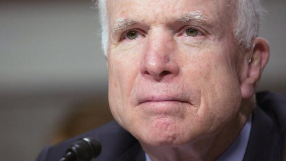 """Chairman Senator John McCain listens during the Senate Armed Services Committee on information surrounding the Marines United Website at the Dirksen Senate Office Building in Washington, DC on March 14, 2017 The Senate Armed Services Committee held the hearing with General Robert Neller, who heads the Marine Corps. The Pentagon faced a burgeoning scandal March 10, 2017 as more pictures of naked female service members apparently shared without their consent by male colleagues have turned up on secret social media sites. The scandal broke over the weekend with the revelation that pictures of female Marines in various stages of undress had been shared in a secret Facebook group called """"Marines United.""""  Membership in the group was restricted to current and former Marines, but it had as many as 30,000 members before it was taken down.  The story was first reported by The War Horse, a news group run by Marine veteran Thomas Brennan.  He said some of the photos were taken surreptitiously, while others had been taken by the women themselves but shared without their consent.  / AFP PHOTO / Tasos Katopodis        (Photo credit should read TASOS KATOPODIS/AFP/Getty Images)"""