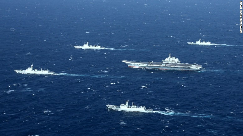 This aerial photo taken on January 2, 2017 shows a Chinese navy formation, including the aircraft carrier Liaoning (C), during military drills in the South China Sea.