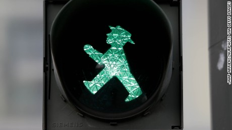 "Berlin is home to the hat-wearing ""Ampelmann"" (traffic light man), a relic of the city's divided past."