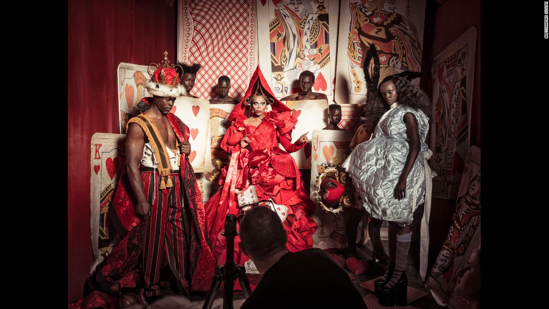 Djimon Hounsou as the King of Hearts and Duckie Thot as Alice flank RuPaul as the Queen of Hearts.