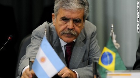 Argentina's Planning Minister Julio De Vido gets ready during a meeting with Brazilian Minister of Mines and Energy Edison Lobao (not in frame), at the Mines and Energy Ministry, in Brasilia, on April 20, 2012. The Argentine government of President Cristina Fernandez de Kirchner declared YPF, the country's largest oil company, subject to expropriation and submitted a bill to parliament that would give the state and oil-producing provinces a 51 percent stake in the company. AFP PHOTO/PEDRO LADEIRA (Photo credit should read PEDRO LADEIRA/AFP/Getty Images)