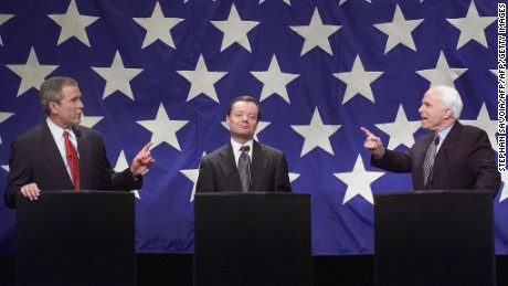Republican Presidential nomination hopefuls (L-R) George W. Bush, Gary Bauer, and John McCain debate in January 2000.