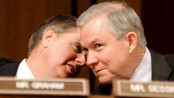 Sessions and Sen. Lindsey Graham, R-South Carolina, confer during a Judiciary Committee confirmation hearing for Alberto R. Gonzales in January 2005. President George W. Bush nominated Gonzales to be  attorney general.