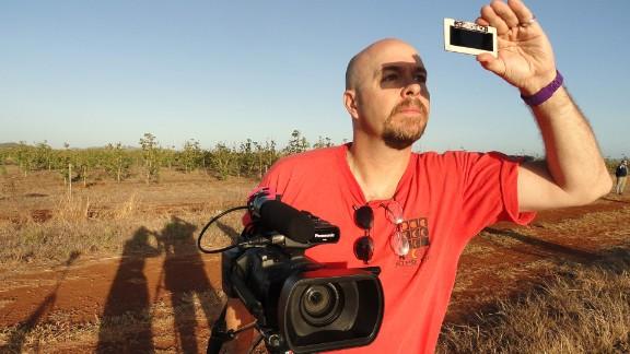 Filmmaker David Makepeace observing a total solar eclipse in Australia in November 2012.