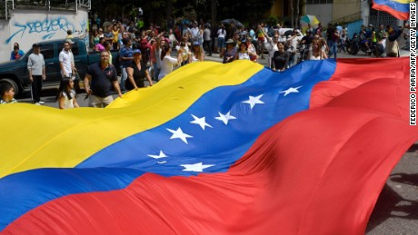 People gather in Caracas on July 16, 2017 during an opposition-organized vote to measure public support for President Nicolas Maduro's plan to rewrite the constitution. Authorities have refused to greenlight the vote that has been presented as an act of civil disobedience and supporters of Maduro are boycotting it. Protests against Maduro since April 1 have brought thousands to the streets demanding elections, but has also left 95 people dead, according to an official toll.  / AFP PHOTO / FEDERICO PARRAFEDERICO PARRA/AFP/Getty Images