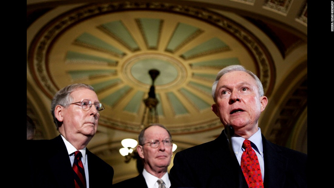 Sessions speaks to reporters in 2009. He is accompanied by Senate Minority Leader Sen. Mitch McConnell of Kentucky, left, and Sen. Lamar Alexander, R-Tennessee.