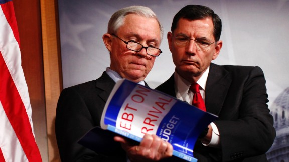 Sessions and Sen. John Barrasso, R-Wyoming, look at a copy of the 2013 budget during a news conference on Capitol Hill in February 2012. Obama's 2013 proposed budget was criticized by Republicans.