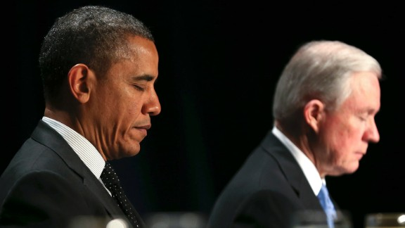 From left: First lady Michelle Obama, President Barack Obama and Sessions pray during the 2013 National Prayer Breakfast in Washington.