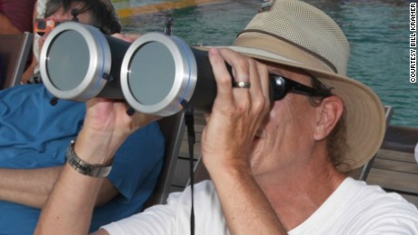 Bill Kramer observing a total solar eclipse through solar filtered binoculars while in Indonesia in 2016.
