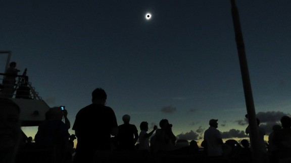 Crowds in Indonesia gather to observe a total solar eclipse in 2016.