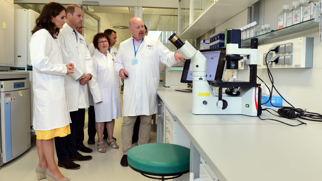 The duke and duchess don lab coats during a visit on July 20, with researchers at the German Cancer Research Institute in Heidelberg.