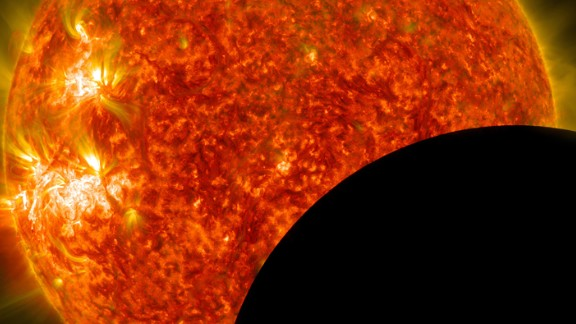 NASA image of the moon crossing in front of the sun.