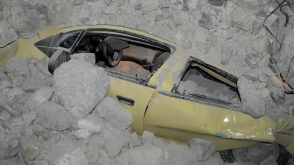A car is enveloped in rubble on Kos in the wake of the earthquake.