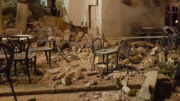 A Kos cafe is littered with rubble following the strong earthquake.