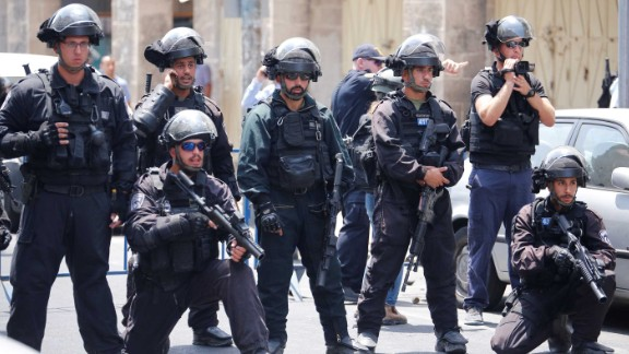 Israeli security forces take security measures as Palestinians gather for Friday prayers outside Herod's Gate in Jerusalem.