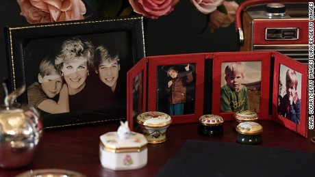 LONDON, ENGLAND - JULY 20:  Photographs of Princes William and Harry and Princess Diana are displayed on a desk used by Princess Diana in Kensington Palace at the Royal Gifts exhibition at this year's Summer Opening of the State Rooms at Buckingham Palace on July 20, 2017 in London, England. The exhibition features gifts to the Queen during her 65-year reign and runs from 22 July to 1 October 2017.  (Photo by Carl Court/Getty Images)
