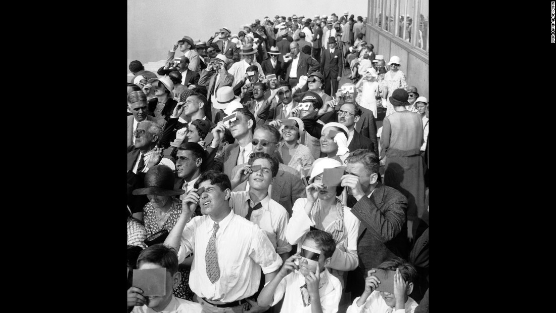 On August 31, 1932, people squinted through protective film to see a partial eclipse of the sun from the top deck of New York's Empire State Building.