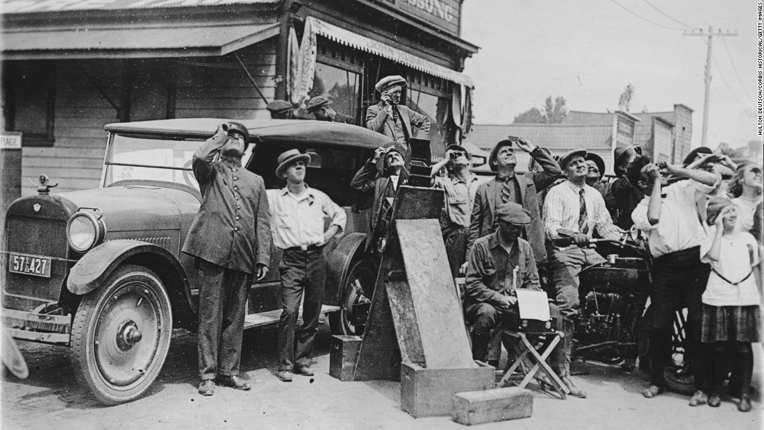 A crowd in a California town observes the total eclipse of the sun in September 1923.