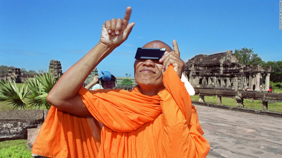 A Cambodian monk watches the beginning of a full solar eclipse with safety glasses in October 1995, during a total eclipse at Angkor Wat. Thousands of tourists and locals witnessed the eclipse at the 12th century monument.