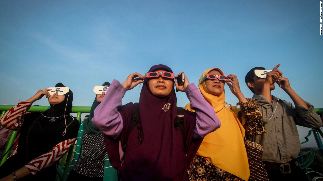 Indonesians use special glasses to observe the solar eclipse on March 09, 2016 in Surakarta, Indonesia.