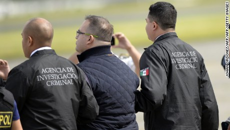Javier Duarte (C), former governor of the Mexican state of Veracruz, is taken under custody to board an aircraft to be extradited to Mexico, in Guatemala City, on July  17, 2017.  Duarte is one of several Mexican ex-governors under arrest for corruption, fraud, money laundering or links to organized crime. / AFP PHOTO / JOHAN ORDONEZ        (Photo credit should read JOHAN ORDONEZ/AFP/Getty Images)