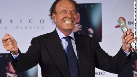 "Spanish singer Julio Iglesias gestures during a press conference in Mexico city, on September 23, 2015. Iglesias is in Mexico to promote his new album ""Mexico"". AFP PHOTO/RONALDO SCHEMIDT        (Photo credit should read RONALDO SCHEMIDT/AFP/Getty Images)"