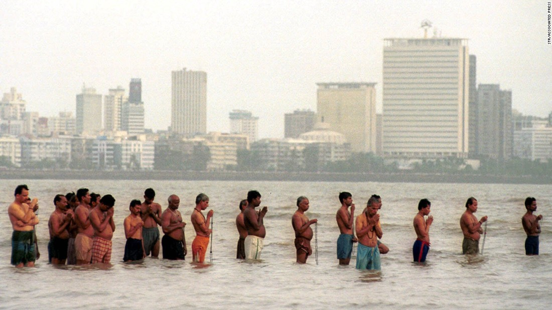 Hindus pray in the Arabian Sea during the last total solar eclipse of the millennium in Bombay, India on August 11, 1999. Millions of viewers enjoyed the millennium's last celestial show in the city.