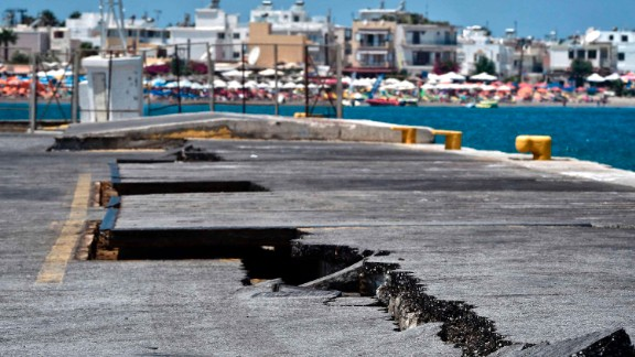 Cracks are seen at the main port on the island of Kos on Friday following the 6.7-magnitude earthquake.