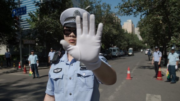 TOPSHOT - Chinese police officers block the road leading to the Philippines embassy in Beijing on July 13, 2016 the day after an international court on July 12 ruled against China in a Philippine challenge over Beijing-occupied territory in the South China Sea. Beijing on July 12 furiously rejected the ruling that rendered its claims in the South China Sea invalid and dealt a devastating diplomatic blow to its ambitions in the resource-rich region. / AFP / NICOLAS ASFOURI        (Photo credit should read NICOLAS ASFOURI/AFP/Getty Images)