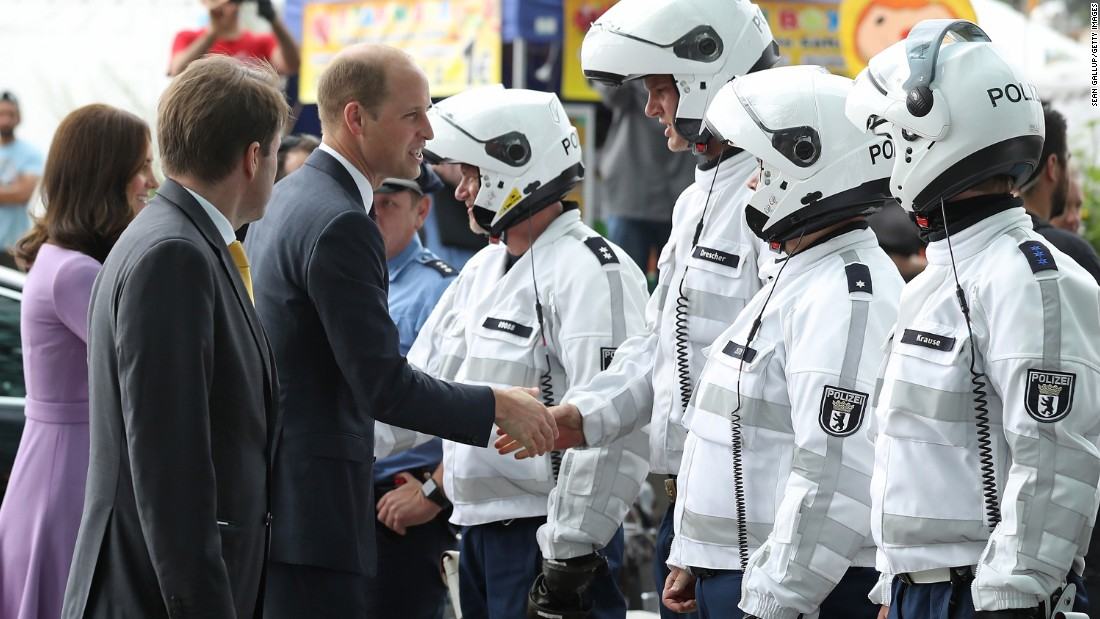 Catherine and William say goodbye to German police officers who had led their motorcade on motorcycles at Berlin Hauptbahnhof main railway station before departing for Hamburg on July 21.