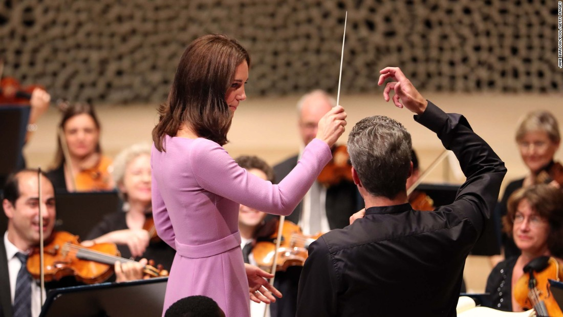 Catherine receives lessons on how to conduct an orchestra at Elbphilharmonie in Hamburg on Friday.