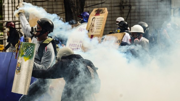 Demonstrators clash with riot police during an anti-government protest in Caracas on July 20, 2017.